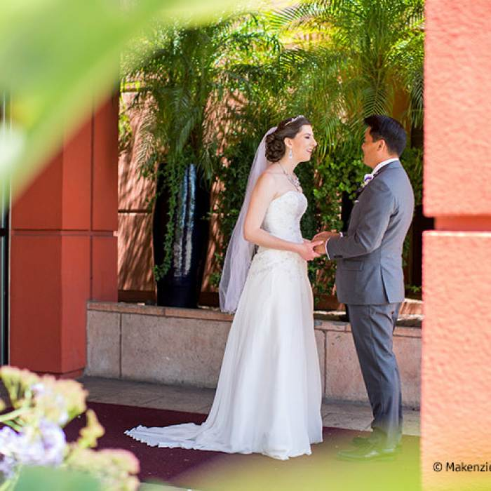 wedding picture of couple standing outside of hotel