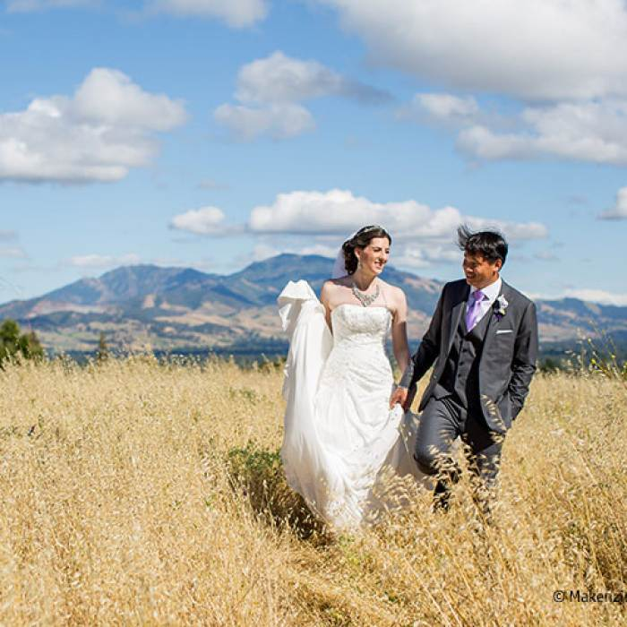 wedding picture of couple in an open field