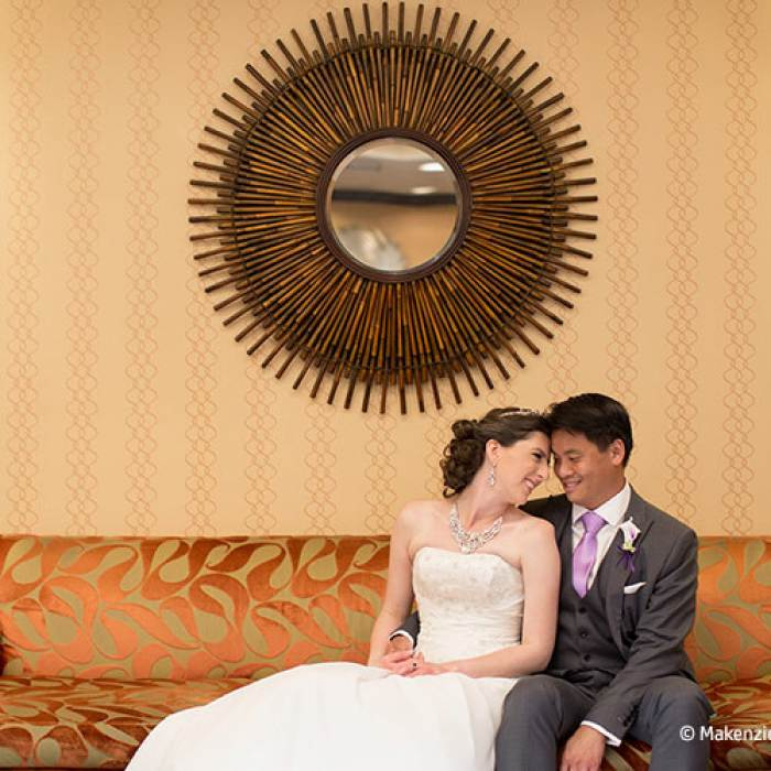 wedding picture of couple sitting on a couch